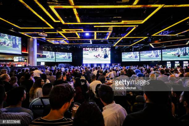 Fans at Star City watch game three of the State Of Origin series between the Queensland Maroons and the New South Wales Blues on July 12 2017 in...