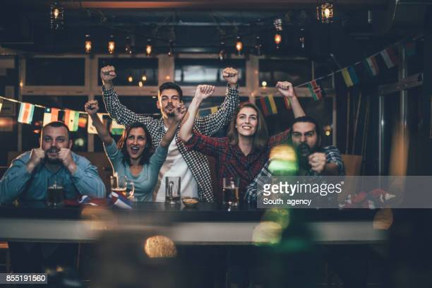 Fans at the bar celebrating