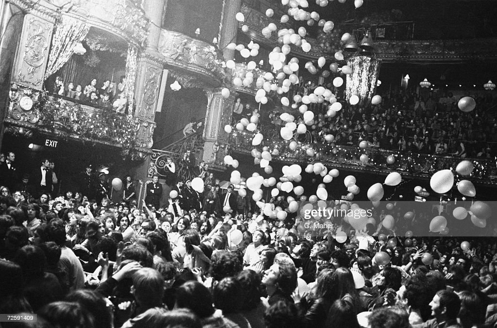 Fans at the Rolling Stones gig at the Lyceum Ballroom in London reach up to catch balloons, 21st December 1969.