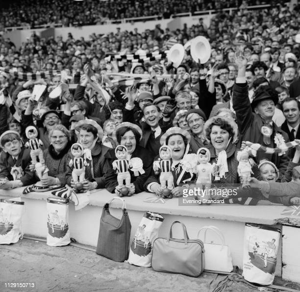 Fans at Wembley Stadium to attend the 1968 FA Cup Final between West Bromwich Albion FC and Everton FC, London, UK, 18th May 1968.