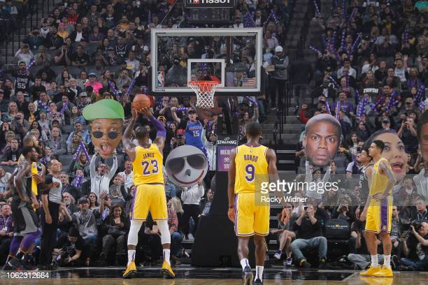 Fans attempt to distract LeBron James as he attempts a free-throw against the Sacramento Kings on November 10, 2018 at Golden 1 Center in Sacramento,...