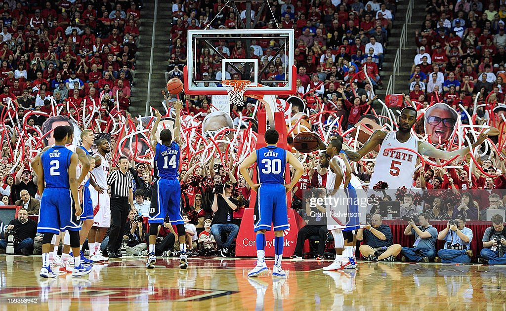 Fans attempt to distract Rasheed Sulaimon #14 of the Duke Blue Devils as he shoots a free throw against the North Carolina State Wolfpack during play at PNC Arena on January 12, 2013 in Raleigh, North Carolina.