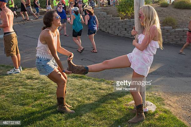 Fans attempt to remove a cowboy boot during the Watershed Music Festival at The Gorge on August 1 2015 in George Washington
