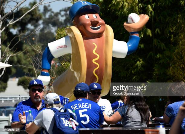 Fans attend a baseball game between San Francisco Giants and Los Angeles Dodgers on Opening Day at Dodger Stadium on March 29 2018 in Los Angeles...