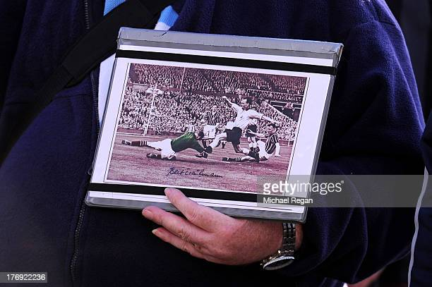 Fans attend a memorial service in remembrance of Bert Trautmann the former goalkeeper who died in July prior to the Barclays Premier League match...