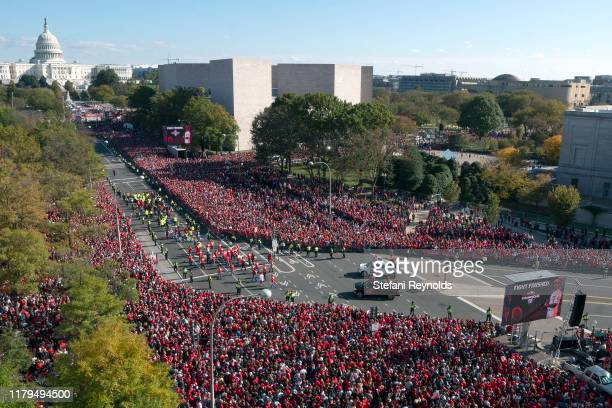 Fans attend a parade to celebrate the Washington Nationals World Series victory over the Houston Astros on November 2 2019 in Washington DC This is...
