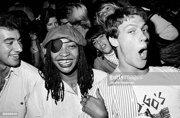 Fans attend a performance at the Whisky a Go Go night club Los Angeles California late 1970s or early 1980s The woman in center wears amn eyepath and...