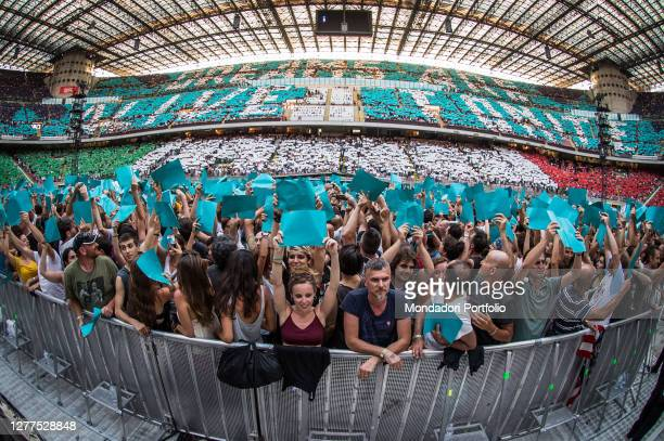 Fans attend as American singer and musician Bruce Springsteen performs live on stage with the E street band at San Siro stadium. Milan , July 3rd 2016