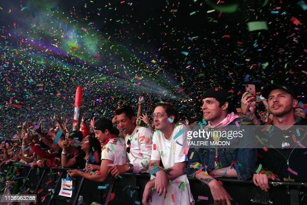 Fans attend Australian band Tame Impala performance on stage at the Coachella Valley Music and Arts Festival on April 13 in Indio California