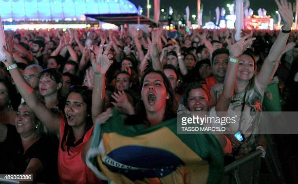 Fans attend Brazilian band Paralamas do Sucesso's performance during the third day of the Rock in Rio music festival at the City of Rock park in Rio...