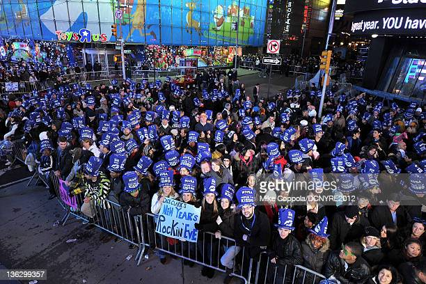 Fans attend Dick Clark's New Year's Rockin' Eve with Ryan Seacrest 2012 at Times Square on December 31, 2011 in New York City.