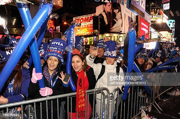Fans attend Dick Clark's New Year's Rockin' Eve with Ryan Seacrest 2012 at Times Square on December 31 2011 in New York City