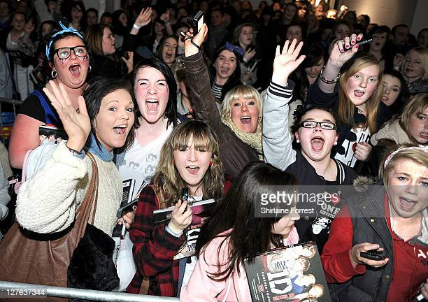 Fans attend One Direction signing their new book 'One Direction Forever Young Our Official XFactor Story' at HMV on March 7 2011 in Manchester England
