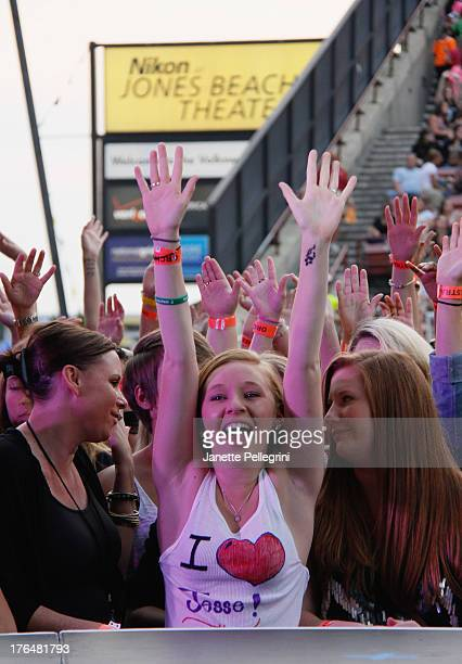 Fans attend the Backstreet Boys concert at Nikon at Jones Beach Theater on August 13 2013 in Wantagh New York