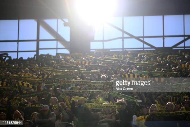 Fans attend the Bundesliga match between Borussia Dortmund and Bayer 04 Leverkusen at Signal Iduna Park on February 24 2019 in Dortmund Germany