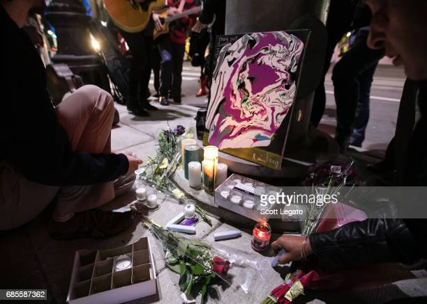 Fans attend the candlelight vigil to mourn the death of singer Chris Cornell at the Fox Theatre, the venue where Chris Cornell performed his final...