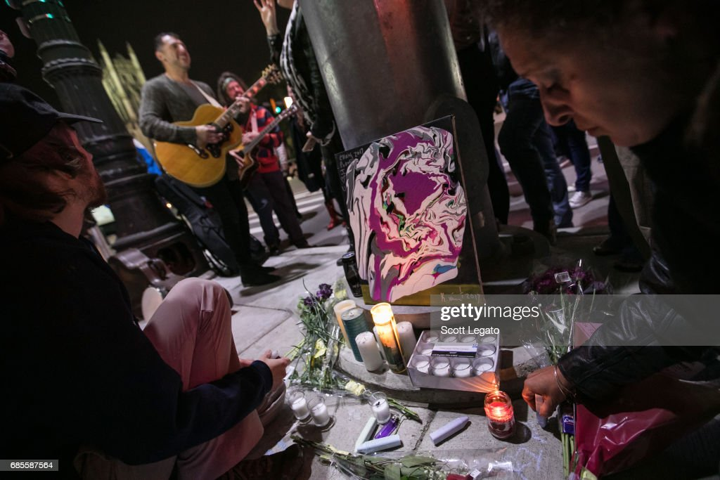 Fans attend the candlelight vigil to mourn the death of singer Chris Cornell at the Fox Theatre, the venue where Chris Cornell performed his final show, on May 19, 2017 in Detroit, Michigan.