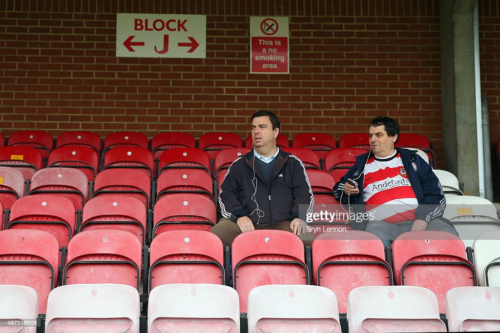 Fans attend the FA Cup Qualifying Third Round match between Kingstonian and Eastbourne Borough at The Cherry Red Records Stadium on October 12, 2014 in Kingston upon Thames, England.