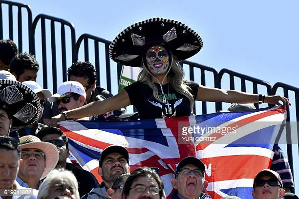 Fans attend the Formula One Mexico Grand Prix qualifying session at the Hermanos Rodriguez circuit in Mexico City on October 29 2016 / AFP / YURI...