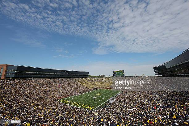 Fans attend the game between Eastern Michigan University Eagles and the University of Michigan Wolverines at Michigan Stadium on September 17 2011 in...