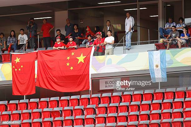 Fans attend the match between China and Argentina during the International Tournament of Brasilia at Mane Garrincha Stadium on December 14 2014 in...