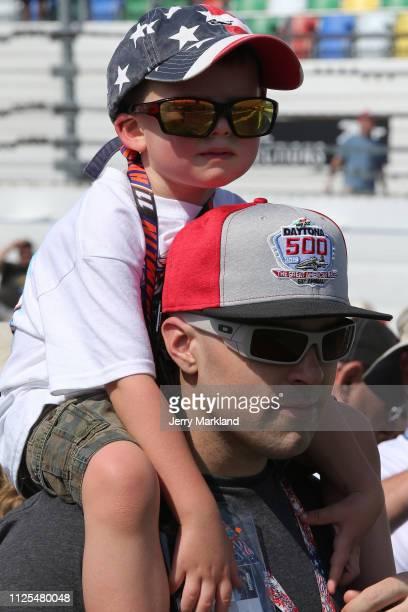Fans attend the Monster Energy NASCAR Cup Series 61st Annual Daytona 500 at Daytona International Speedway on February 17 2019 in Daytona Beach...