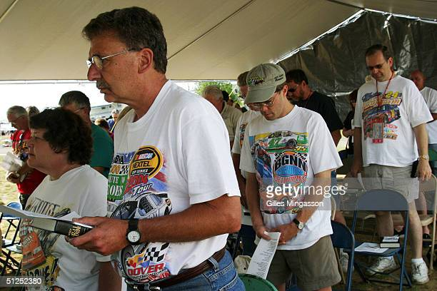 NASCAR fans attends a religious service Sunday morning in a makeshift chapel just outside of the race track July 24 2004 in Loudon New Hamshire...