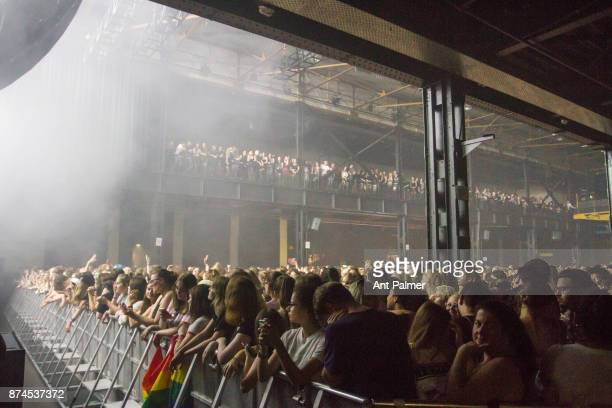 Fans await the arrival of The 1975 on stage at the Palladium on June 21 2017 in Cologne Germany