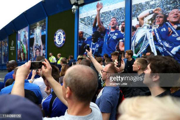 Fans await the arrival of the team bus ahead of the Premier League match between Chelsea FC and Burnley FC at Stamford Bridge on April 22 2019 in...