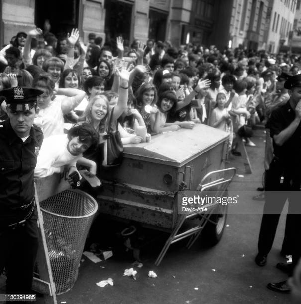 Fans await the Beatles outside their hotel the Delmonico on 59th Street and Park Avenue on August 28 1964 as the Beatles prepare to play two concerts...