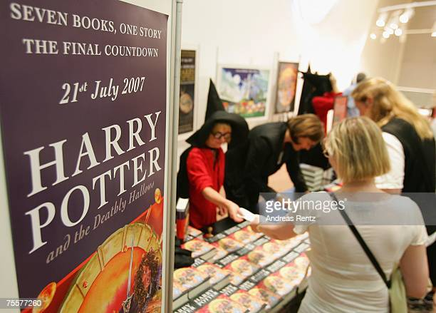 Fans await the last book by JK Rowling Harry Potter and the Deathly Hallows at a bookstore after its release at 101am on July 21 2007 in Berlin...