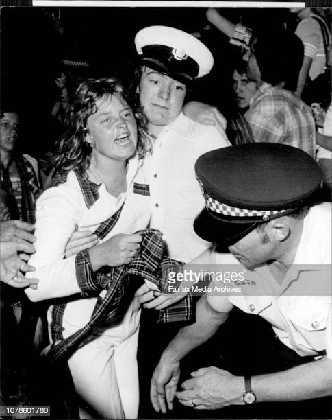 Fans being carried out after fainting, fans crying etc.Bay City Roller concert at the Hordern Pavilion....December 01, 1976. .
