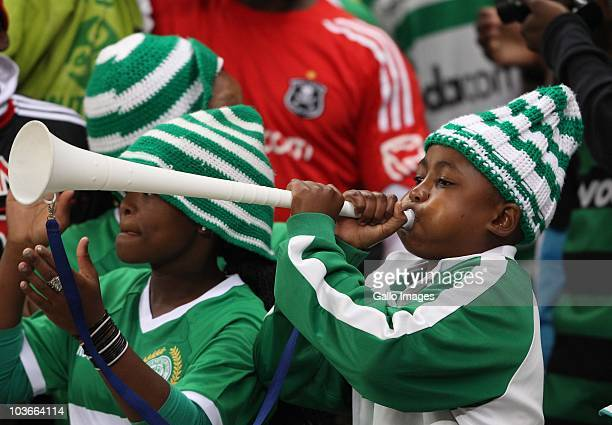 Fans blow vuvuzelas 2during the Absa Premiership match between Vasco Da Gama and Orlando Pirates, at Cape Town Stadium on August 27, 2010 in Cape...