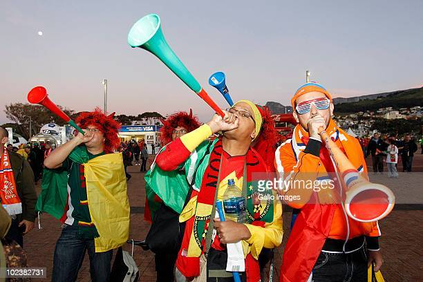 Fans blow vuvuzelas during the 2010 FIFA World Cup South Africa Group E match between Cameroon and Netherlands at Cape Town Stadium on June 24 2010...