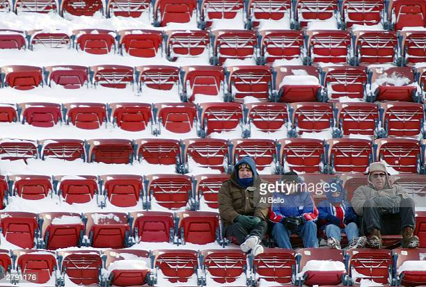 Fans brave the cold weather at the New York Giants verses Washington Redskins game on December 7, 2003 at Giants Stadium in East Rutherford, New...
