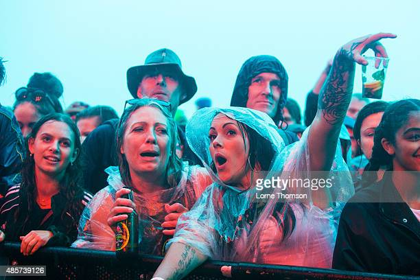 Fans brave the rain during The Fratellis set at Southsea Seafront on August 29 2015 in Portsmouth England