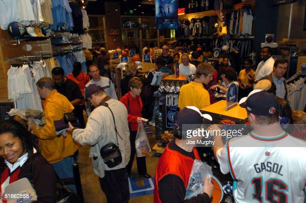 Fans browse the team store before a Memphis Grizzlies game against the Washington Wizards on opening night on Novemeber 3, 2004 at Fedex Forum in...