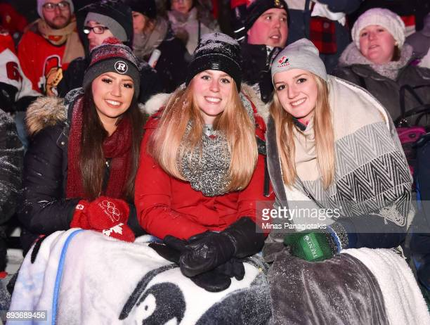 Fans bundle up during the 2017 Scotiabank NHL100 Classic Ottawa Senators Alumni Game on Parliament Hill on December 15 2017 in Ottawa Canada