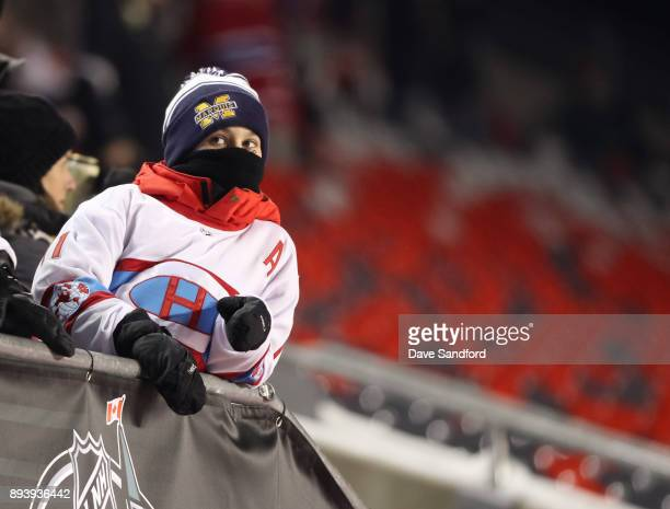 Fans bundle up in advance of the 2017 Scotiabank NHL100 Classic at Lansdowne Park on December 16 2017 in Ottawa Canada