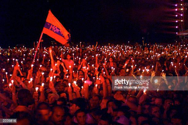 Fans burn candles at Woodstock 99 in Rome New York The Woodstock 99 festival will feature over 45 bands on four stages on July 23and 25th Crowd...