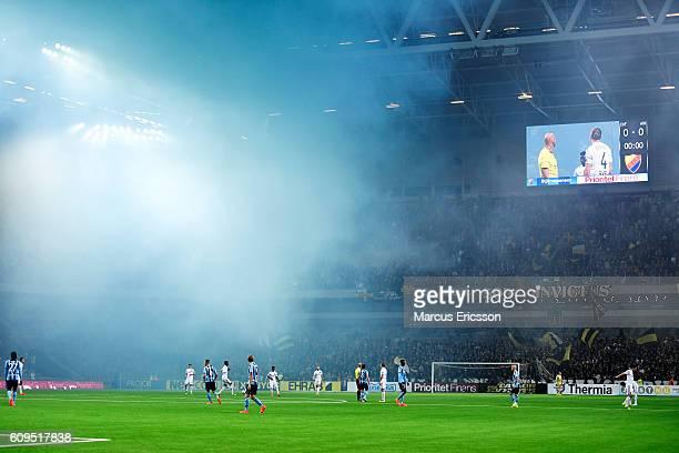 Fans burning flair during the Allsvenskan match between Djurgardens IF and AIK at Tele2 Arena on September 21 2016 in Stockholm Sweden