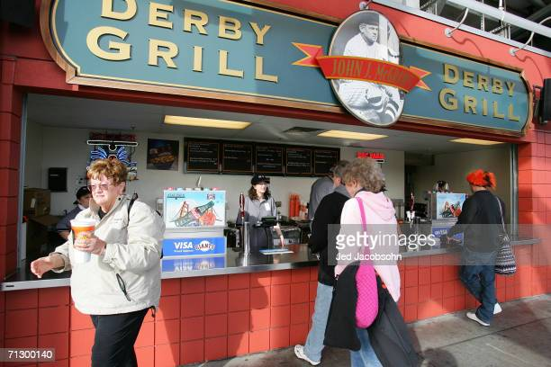 Fans buy food at the Dirby Grill as the San Francisco Giants play against the Los Angeles Dodgers during the MLB game at ATT Park on May 12 2006 in...