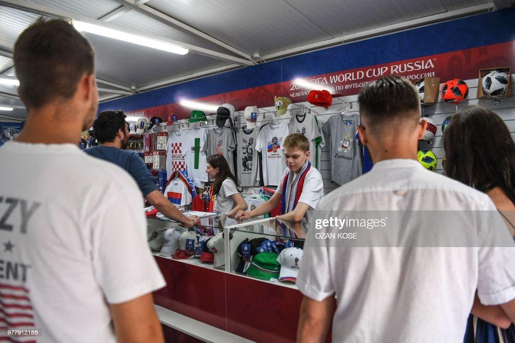 Fans Buy Goodies In An Official Fifa Football Fan Shop In