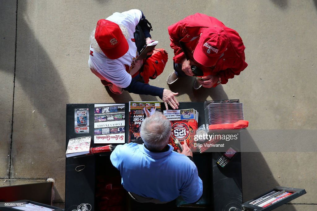Fans buy programs prior to the 2017 MLB Opening Day game between the St. Louis Cardinals and the Chicago Cubs game at Busch Stadiumon April 2, 2017 in St. Louis, Missouri.