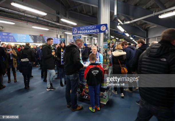 Fans buy the match day programme before the Emirates FA Cup Fifth Round match between Brighton and Hove Albion and Coventry City at Amex Stadium on...