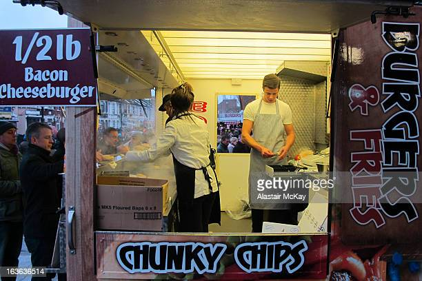 Fans buying burgers before a West Ham football match at the Boleyn Ground , Green Street, Newham, east London.