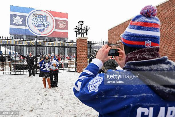Fans capture memories prior to the Detroit Red Wings playing the Toronto Maple Leafs before the 2014 Bridgestone NHL Winter Classic on January 1 2014...