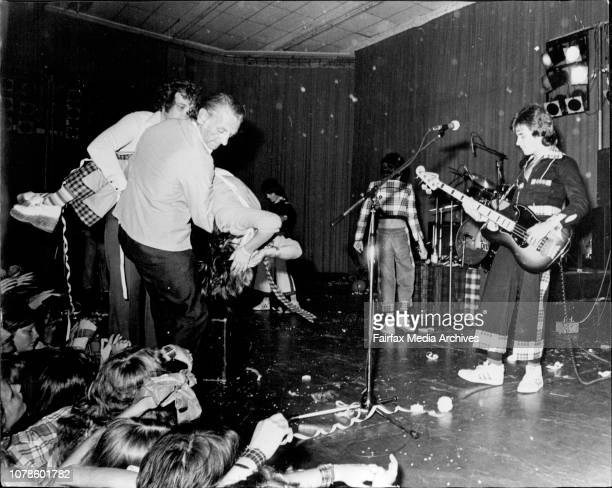 Fans carried form the Pavilion during the performance of the Bay City Rollers after fainting etc etc etc.Ist Sydney concert of the Scottish group,...