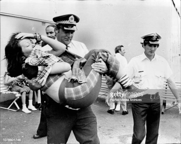 Fans carried from the Pavilion during the performance of the Bay City Rollers after fainting etc etc etc.Ist Sydney concert of the Scottish group,...