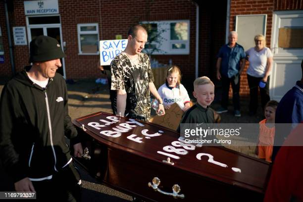 Fans carry a coffin outside Bury Football Club as they await a rescue plan for the illfated club on August 23 2019 in Bury England Bury Football Club...